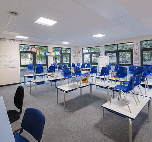 modular classroom with chairs on tables