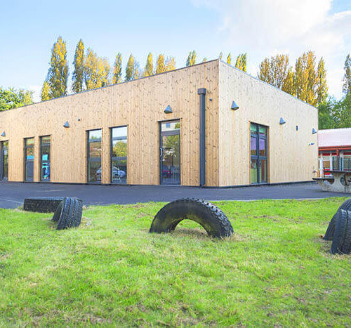 school building with tire playground